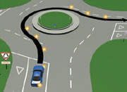 Picture of a car signalling right at a multi-laned roundabout