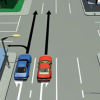 Picture of a car passing on the left at a laned intersection