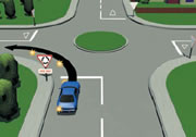 Picture of a car signalling left at a single-laned roundabout