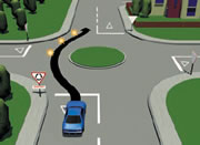 Picture of a car driving straight through a single-laned roundabout